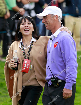 U.S. team captain Corey Pavin and his wife Lisa laugh during the second day of the 2010 Ryder Cup golf tournament at the Celtic Manor Resort in Newport, Wales