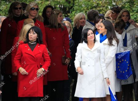 Lisa Pavin, left, wife of U.S. team captain Corey Pavin and Gaynor Montgomerie, wife of Europe team captain Colin Montgomerie lead out the wives and partners of the players to attend the opening ceremony 2010 Ryder Cup golf tournament at the Celtic Manor golf course in Newport, Wales