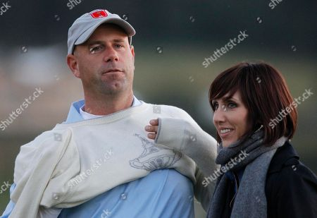 Stewart Cink of the U.S. and his wife Lisa react during the 2010 Ryder Cup golf tournament at the Celtic Manor golf course in Newport, Wales