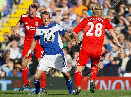 Liverpool's Christian Poulsen, right, and Jamie Carragher, left, vie for the ball with Birmingham's Lee Bowyer during their English Premier League soccer match at Birmingham's St Andrew's Stadium in Birmingham, . (AP Photo/Kirsty Wigglesworth) ** NO INTERNET/MOBILE USAGE WITHOUT FOOTBALL ASSOCIATION PREMIER LEAGUE(FAPL)LICENCE. CALL +44