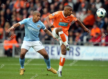 Blackpool's Elliot Grandin, right, vies for the ball with Manchester City's Nigel De Jong, left, during their English Premier League soccer match at Bloomfield Road, Blackpool, England, . (AP Photo/Scott Heppell) ** NO INTERNET/MOBILE USAGE WITHOUT FOOTBALL ASSOCIATION PREMIER LEAGUE(FAPL)LICENCE. CALL +44