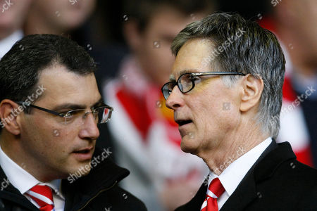 Liverpool co-owner John W Henry, right, stands alongside the club's Director of Football Damien Comolli before the team's English Premier League soccer match against Chelsea at Anfield Stadium, Liverpool, England, . (AP Photo/Tim Hales) **NO INTERNET/MOBILE USAGE WITHOUT FOOTBALL ASSOCIATION PREMIER LEAGUE