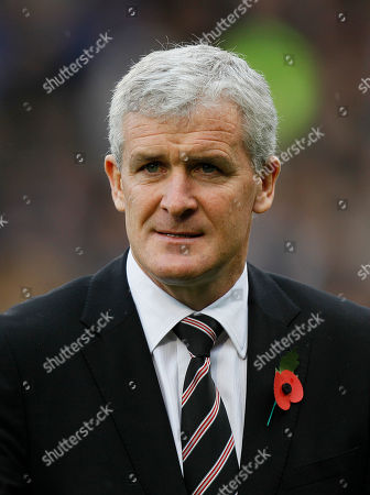Fulham's manager Mark Hughes ahead of their English Premier League soccer match against Aston Villa at Fulham's Craven Cottage Stadium in London, . (AP Photo/Kirsty Wigglesworth) ** NO INTERNET/MOBILE USAGE WITHOUT FOOTBALL ASSOCIATION PREMIER LEAGUE(FAPL)LICENCE. CALL +44