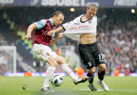 Mark Noble, Bjorn Helge Riise West Ham United's Mark Noble, left, tussles with Fulham's Bjorn Helge Riise during their English Premier League soccer match at Upton Park, London, . (AP Photo/Sang Tan) ** NO INTERNET/MOBILE USAGE WITHOUT FOOTBALL ASSOCIATION PREMIER LEAGUE (FAPL) LICENCE - CALL +44