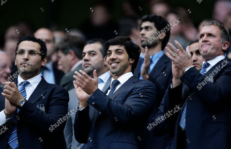 Manchester City's owner Sheikh Mansour, centre, applauds as he stands between chief executive Garry Cook, right, and chairman Khaldoon Al Mubarak before his team's English Premier League soccer match against Liverpool at The City of Manchester Stadium, Manchester, England, . (AP Photo/Jon Super) **NO INTERNET/MOBILE USAGE WITHOUT FOOTBALL ASSOCIATION PREMIER LEAGUE