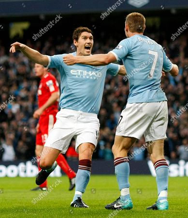 Gareth Barry, James Milner Manchester City's Gareth Barry, left, is congratulated by team mate James Milner after he scored a goal against Liverpool during their English Premier League soccer match at the City of Manchester Stadium, Manchester, England, . (AP Photo/Tim Hales) ** NO INTERNET/MOBILE USAGE WITHOUT FOOTBALL ASSOCIATION PREMIER LEAGUE (FAPL) LICENCE. CALL +44