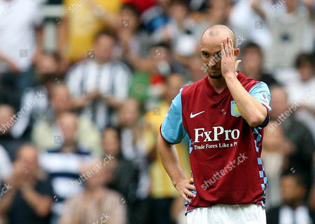 Aston Villa's Stephen Ireland reacts at the end of their English Premier League soccer match against Newcastle United at St James' Park, Newcastle, England, . (AP Photo/Scott Heppell) ** NO INTERNET/MOBILE USAGE WITHOUT FOOTBALL ASSOCIATION PREMIER LEAGUE(FAPL)LICENCE. CALL +44