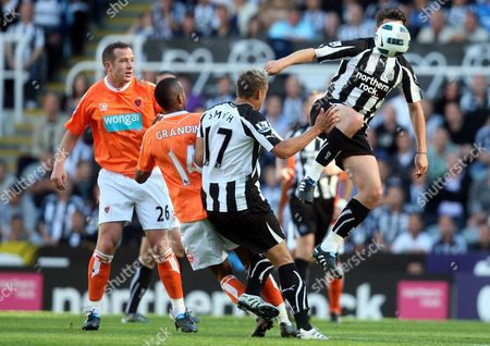 Newcastle United's Joey Barton, right, vies for the ball with Blackpool's Elliot Grandin, center, and captain Charlie Adam, left, during their English Premier League soccer match at St James' Park, Newcastle, England, . (AP Photo/Scott Heppell) ** NO INTERNET/MOBILE USAGE WITHOUT FOOTBALL ASSOCIATION PREMIER LEAGUE(FAPL)LICENCE. CALL +44