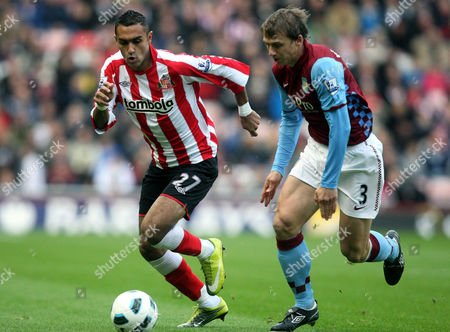 Sunderland's Ahmed Elmohamady, left, vies for the ball with Aston Villa's Stephen Warnock, right, during their English Premier League soccer match at the Stadium of Light, Sunderland, England, . (AP Photo/Scott Heppell) ** NO INTERNET/MOBILE USAGE WITHOUT FOOTBALL ASSOCIATION PREMIER LEAGUE(FAPL)LICENCE. CALL +44