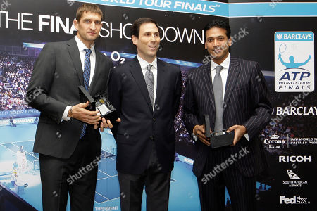 Mahesh Bhupathi, Max Mirnyi, Adam Helfant Mahesh Bhupathi of India, right, and his double partnet Max Mirnyi of Belarus, left, pose with ATP Executive Chairman & President, Adam Helfant during the players presentation in London ahead of the ATP World Tour Finals, . The ATP World Tour finals will be held in London at the O2 Arena starting Sunday, Nov. 21