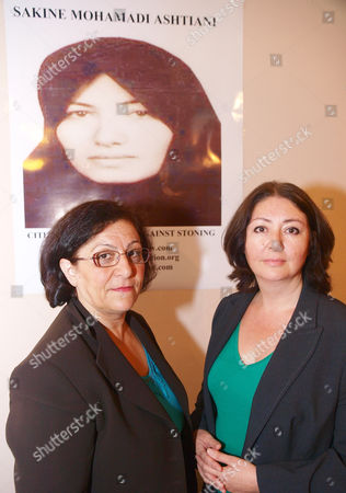 Stock Image of Representative for the anti-capital punishment organization, the International Committee Against Executions and the International Committee Against Stoning., with coordinator Mina Ahadi and Iranian Solidarity Spokesperson Maryam Namazie, right, before the start of their press conference in London, in support of Sakineh Mohammadi Ashtiani, seen in poster background, who is sentenced to stoning after an Iranian court found her guilty of having sex outside of marriage. The anti captial punishment group hope to boldter international support to their cause and bring a reprieve for the stoning of Sakineh Mohammadi Ashtiani