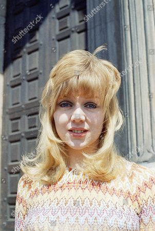"""Carol Hawkins British actress Carol Hawkins, 22, from North London, poses amidst the colonnades of St. Paul's Cathedral, Parish Church of the City of London in June 1971, during a visit to the metropolis. She is starring in the film version of the successful television series """"Please Sir,"""" a comedy about school life. After the film production in which she plays the role of Sharon, she is scheduled to take over the same role in the new TV series"""