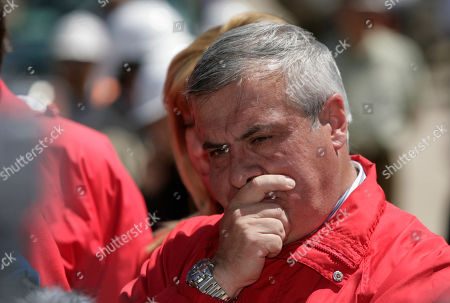 Chile's Health Minster Jaime Manalich looks on during a press conference at the San Jose Mine, near Copiapo, Chile . Authorities said all would be in place at midnight Tuesday to begin the rescue of the 33 trapped miners