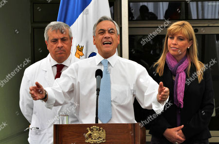 Sebastain Pinera, Jaime Manalich, Ximena Matas Chile's President Sebastian Pinera, center, speaks to the press flanked by his Minister of Health, Jaime Manalich, left, and Atacama's region Governor Ximena Matas at the hospital in Copiapo, Chile, . The 33 rescued miners are undergoing a medical check up after ending their ordeal that began last Aug. 5 when a cave-in nearly killed them and which has captured worldwide attention