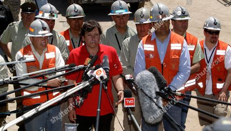 Laurence Golborne Chile's Mining Minister Laurence Golborne, second left front row, talks to journalists during a press conference with the team of mine rescuers that took part in the rescue operation of the 33 trapped miners, at the San Jose mine near Copiapo, Chile, . The 69-day underground ordeal reached its end Wednesday night after 33 trapped miners were hauled up in a cage through a narrow hole drilled through 2,000 feet (700 meters) of rock