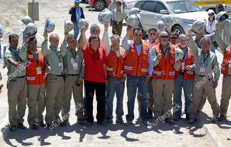 Laurence Golborne Chile's Mining Minister Laurence Golborne, fifth from left, poses for photos with the team of mine rescuers that took part in the rescue operation of the 33 trapped miners, at the San Jose mine near Copiapo, Chile, . The 69-day underground ordeal reached its end Wednesday night after 33 trapped miners were hauled up in a cage through a narrow hole drilled through 2,000 feet (700 meters) of rock