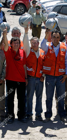 Andres Sougarret, Laurence Golborne Andres Sougarret, center, the chief engineer in charge of the rescue mission of 33 trapped miners, poses for pictures with Chile's Mining Minister Laurence Golborne, left, mine rescuer Rene Aguilar, right, and other rescuers, not seen, at the San Jose Mine near Copiapo, Chile, . Sougarret, a 46-year-old mining engineer, was in charge of digging the miners out