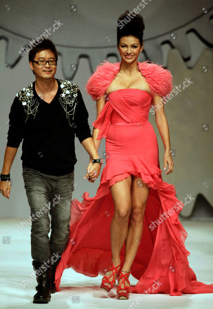 Stock Photo of Hong Kong model Rosemary Vandenbroucke walks with designer Dorian Ho during a fashion show for the Dorain Ho collection at China Fashion Week in Beijing, China on . A Nevada judge has set a Feb. 9 preliminary hearing for Vandenbroucke, the 28-year-old fashion model from Hong Kong who was arrested on a drug charge at the Burning Man counterculture festival earlier this year