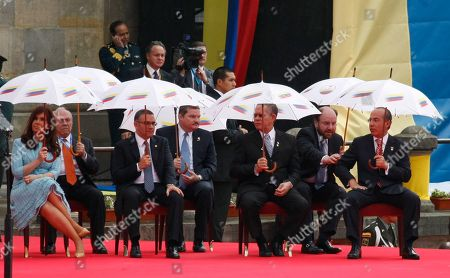 Cristina Fernandez, Mauricio Funes, Orette Bruce Golding, Felipe Calderon First row from left: Argentina's President Cristina Fernandez, El Salvador's President Mauricio Funes, Jamaica's Prime Minister Orette Bruce Golding and Mexico's President Felipe Calderon attend the swearing-in ceremony of Colombia's President Juan Manuel Santos in Bogota, Colombia