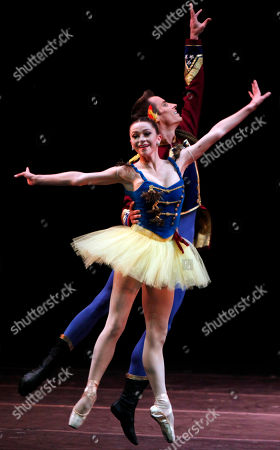 """Megan Fairchild, Andrew Veyette Megan Fairchild, left, and Andrew Veyette, principal dancers of the New York City Ballet, perform """"Stars and Stripes"""", choreographed by George Balanchine at the Mella Theatre during the 22nd International Ballet Festival in Havana, Cuba"""