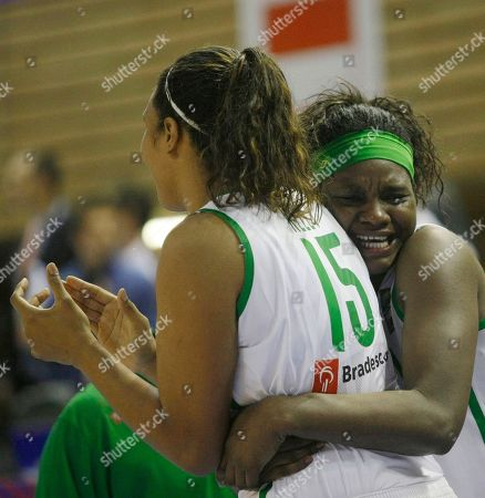 Kelly Santos Muller, Silvia Gustavo Rocha Kelly Santos Muller, left, of Brazil is hugged by her teammate Silvia Gustavo Rocha, right, during the World Basketball Championship round of 16 match against Japan in Brno, Czech Republic, . Brazil won the match 93-91 in over time