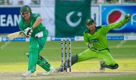 Pakistan's wicket keeper Zulqarnain Haider snags the ball to stop South Africa's AB de Villiers getting another run, during the fourth One Day International Cricket match between Pakistan and South Africa, at the Dubai International Cricket Stadium in Dubai