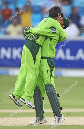 Pakistan's wicketkeeper Zulqarnain Haider, right, and teammate Mohammad Hafeez, left, celebrate after bowling out South Africa's David Miller during their third one day international cricket match in Dubai, UAE