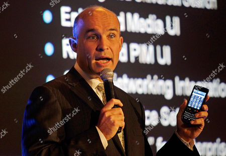 Jim Balsillie, Co-CEO Research In Motion, RIM, maker of BlackBerry, shows a BlackBerry Torch 9800 as he provides an update on the latest BlackBerry product developments during the GITEX exhibition in Dubai, United Arab Emirates