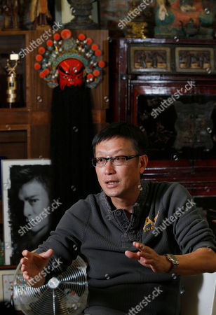 """Andrew Lau On, Hong Kong director Andrew Lau speaks during an interview with The Associated Press in Hong Kong. Lau said he's shed the baggage of his hit crime thriller """"Infernal Affairs"""" which was remade by Martin Scorsese, as he prepares to release a new kung fu blockbuster starring Donnie Yen"""