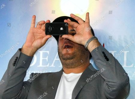 """Kevin Asch U.S. director Kevin Asch takes a photo during a photocall for the film """" Holly Rollers """" at the 36th American Film Festival, in Deauville, Normandy, France"""