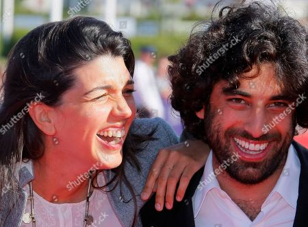 """Zeina Durra, Karim Saleh British director Zeina Durra and french actor Karim Saleh arrive for the screening of the film """" The Imperialist Are Still Alive """" at the 36th American Film Festival, in Deauville, Normandy, France"""