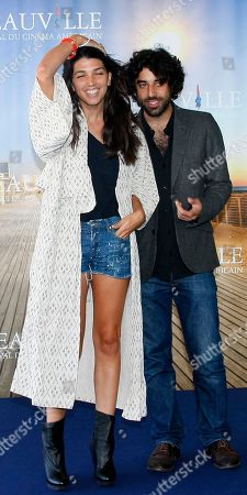 """Zeina Durra, Karim Saleh British director Zeina Durra poses for photographers with French actor Karim Saleh for the film """" The Imperialist Are Still Alive """" at the 36th American Film Festival, in Deauville, Normandy, France"""
