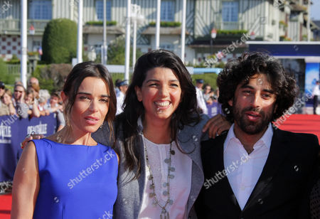 """Elodie Bouchez, Zeina Durra, Karim Saleh Left to right, french actress Elodie Bouchez, British director Zeina Durra and french actor Karim Saleh arrive for the screening of the film """" The Imperialist Are Still Alive """" at the 36th American Film Festival, in Deauville, Normandy, France"""