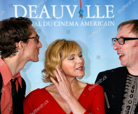 "U.S. actress Kim Cattrall poses for photographers with U.S. actor Dustin Ingram, left, and U.S. director Keith Bearden for the film "" Meet Monica Velour "" at the 36th American Film Festival, in Deauville, Normandy, France"