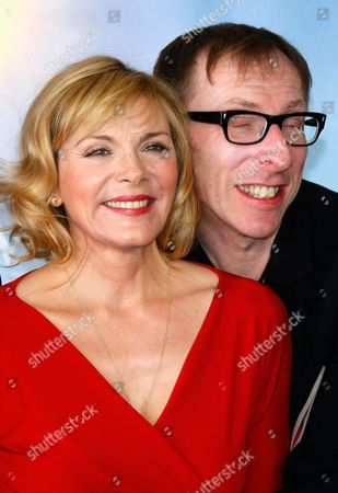 "U.S. actress Kim Cattrall poses for photographers with U.S. director Keith Bearden for the film "" Meet Monica Velour "" at the 36th American Film Festival, in Deauville, Normandy, France"