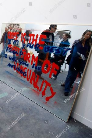 "Stock Photo of Visitors are reflected as they look at ""Crime is The Highest Form of Sensuality"" by US artist Sam Durant displayed at the Grand Palais in Paris, during the Paris FIAC, International Contemporary Art Fair, which runs from Oct. 21 to 24, 2010"