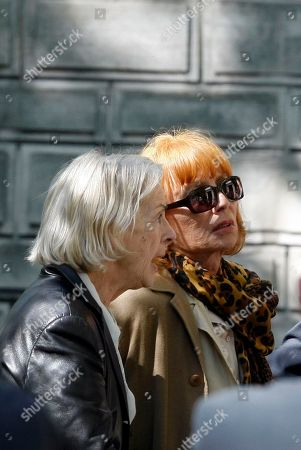 Stock Image of Aurore Pajot, left, and actress Stephane Audran, former wives of late French director Claude Chabrol, attend his funeral at Pere Lachaise Cemetery in Paris . Chabrol, one of the founders of the New Wave movement whose films probed the latent malice beneath the placid surface of bourgeois life died Sunday Sept. 12, 2010, at the age of 80