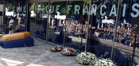 The coffin of French director Claude Chabrol is displayed during a public homage at the Cinematheque Francaise in Paris . Chabrol, one of the founders of the New Wave movement whose films probed the latent malice beneath the placid surface of bourgeois life died Sunday Sept. 12, 2010 at the age of 80