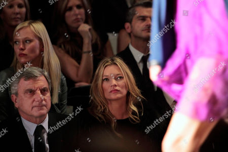 Kate Moss, Sydney Toledano Dior CEO Sydney Toledano, left, and British model Kate Moss, center, attends to British fashion designer John Galliano's ready-to-wear spring-summer 2011 fashion collection for Dior, in Paris, Friday Oct.1, 2010