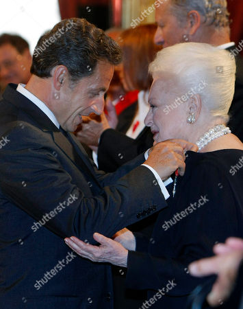 Olivia de Havilland, Nicolas Sarkozy French President Nicolas Sarkozy, left, presents Japan born British actress Olivia de Havilland, right, with the Knight of the Legion of Honor, at the Elysee Palace, in Paris