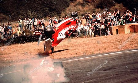 Gilles Villeneuve hits Ronnie Peterson and crashes into the crowd killing a marshal and a photographer