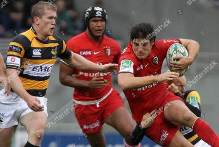 David Skrela,Thierry Dusautoir,Tom Rees Toulouse's David Skrela is tackled by London Wasps' Joseph Simpson, right, as Toulouse's Thierry Dusautoir, background, and London Wasps' Tom Rees, left, look on during their Heineken European Cup rugby union match in Toulouse, southwestern France
