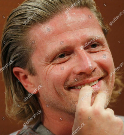 Emmanuel Petit Former French soccer player Emmanuel Petit listens during a press conference, in Paris, as he promotes the 2011 Homeless Soccer World Cup that will take place in Paris Aug.19 - 29, 2011. About 70 countries are expected to take part to the competition