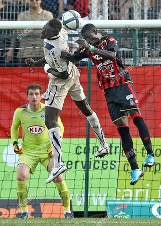 Eric Mouloungui, Ludovic Sane, Cedric Carrasso Nice's Eric Mouloungui of Gabon, right, jumps for the ball with Bordeaux's Ludovic Sane of France in front of Bordeaux's goalkeeper Cedric Carrasso of France during their French League One soccer match, in Nice stadium, southeastern France