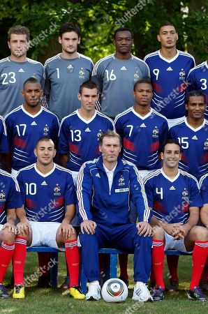 Cedric Carrasso, Hugo Lloris, Steve Mandanda, Guillaume Hoareau, Yann M'Vila, Anthony Reveillere, Loic Remy, Florent Malouda, Karim Benzema, Laurent Blanc, Adil Rami France soccer team poses for a group picture at their training center in Clairefontaine, southwest of Paris ahead of their opening Euro 2012 qualifiers. Top, from left, Cedric Carrasso, Hugo Lloris, Steve Mandanda, Guillaume Hoareau, 2nd row, from left, Yann M'Vila, Anthony Reveillere, Loic Remy, Florent Malouda. 1st row from left, Karim Benzema, coach Laurent Blanc, Adil Rami