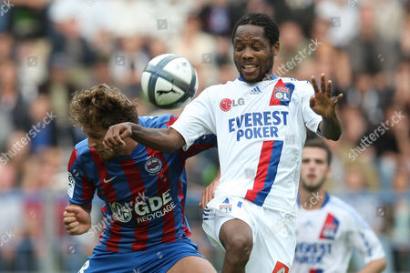Jean II Makoun, Damien Marcq Lyon's Cameroon midfielder Jean II Makoun, centre, jumps for a header against Caen's French defender Damein Marcq during their French Premier League soccer match, in Caen, northwestern France. Caen won 3-2