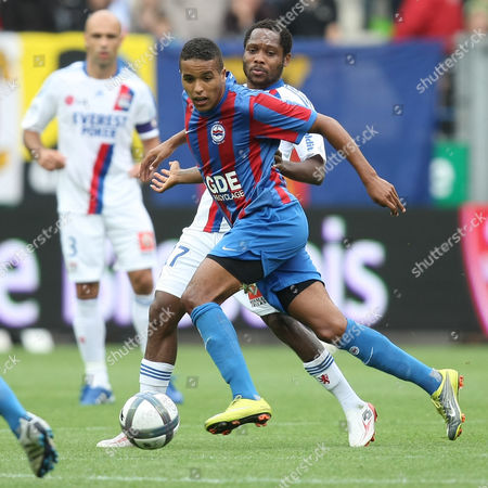 Youssef El Arabi, Jean II Makoun Caen's forward Youssef El Arabi of Morocco challenges for the ball with Lyon's midfielder Jean II Makoun during their French Premier League soccer match, in Caen, northwestern France. Caen won 3-2
