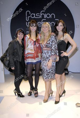 Stock Image of The Hollyoaks girls take to the catwalk : left to right, Jessica Fox, Louie Batler, Sarah Jane Buckley and Summer Strallen. (new girl Summer is the niece of Bonnie Langford)