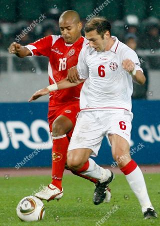 Malta's Jamie Pace, left, and Georgia's Zurab Khizanishvili struggle for the ball during their Euro 2012 Group F qualifying soccer match in Tbilisi, Georgia, on