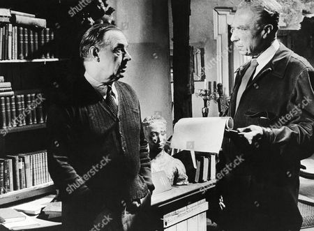 """Stock Photo of German Erich Maria Remarque, left, author of """"A Time to Love and a Time to Die"""", which Universal-International has brought to the screen, starring John Gavin and Lilo Pulver, receives instructions from Danish-German director Douglas Sirk for his role in the film of Professor Pohlmann in 1957 in Berlin, Germany. The acting stint was the first for the world renown author"""